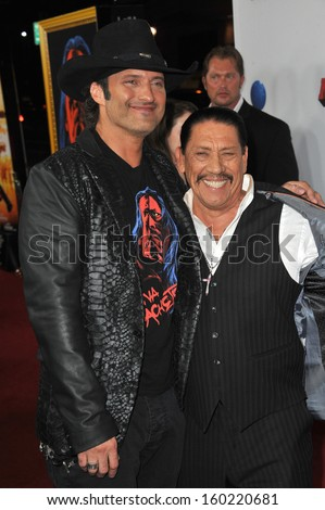 "LOS ANGELES, CA - OCTOBER 2, 2013: Danny Trejo & writer/director Robert Rodriguez (left) at the Los Angeles premiere of their movie ""Machete Kills"" at the Regal Cinemas LA Live."