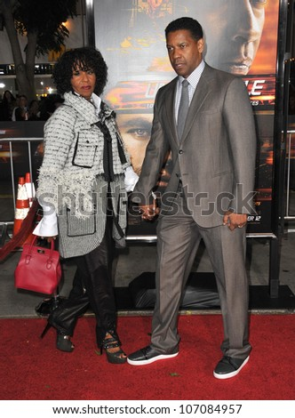 "LOS ANGELES, CA - OCTOBER 26, 2010: Denzel Washington & wife Paulette Washington at the world premiere of his new movie ""Unstoppable"" at the Regency Village Theatre, Westwood."