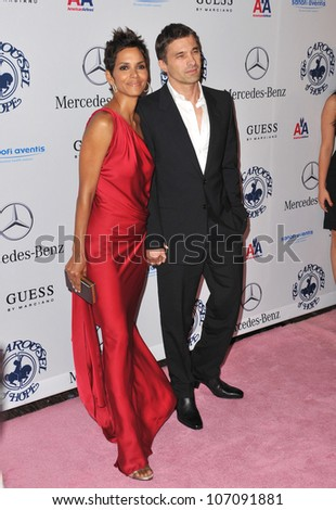 LOS ANGELES, CA - OCTOBER 23, 2010: Halle Berry & boyfriend Olivier Martinez at the 32nd Anniversary Carousel of Hope Ball at the Beverly Hilton Hotel. - stock photo