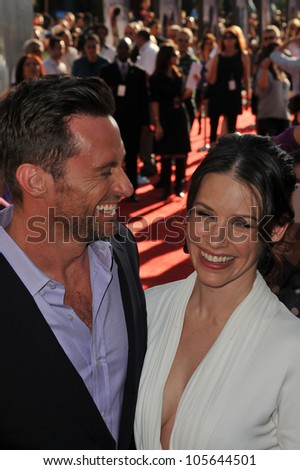 """LOS ANGELES, CA - OCTOBER 2, 2011: Hugh Jackman & Evangeline Lilly at the Los Angeles premiere of their new movie """"Real Steel"""" at Universal Studios Hollywood. October 2, 2011  Los Angeles, CA - stock photo"""
