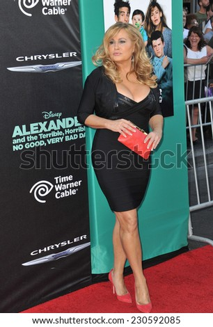 "LOS ANGELES, CA - OCTOBER 6, 2014: Jennifer Coolidge at the world premiere of her movie ""Alexander and the Terrible, Horrible, No Good, Very Bad Day"" at the El Capitan Theatre, Hollywood.  - stock photo"