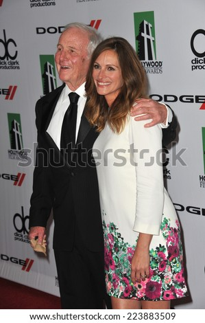 LOS ANGELES, CA - OCTOBER 13, 2013: Julia Roberts & Jerry Weintraub at the 17th Annual Hollywood Film Awards at the Beverly Hilton Hotel.  - stock photo