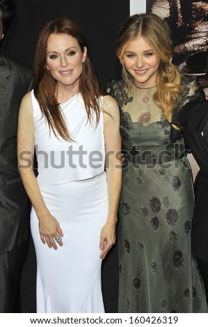 """LOS ANGELES, CA - OCTOBER 7, 2013: Julianne Moore & Chloe Grace Moretz at the world premiere of their movie """"Carrie"""" at the Arclight Theatre, Hollywood.  - stock photo"""