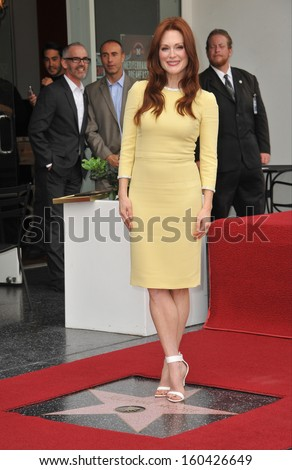 LOS ANGELES, CA - OCTOBER 3, 2013: Julianne Moore on Hollywood Blvd where she was honored with the 2,507th star on the Hollywood Walk of Fame.