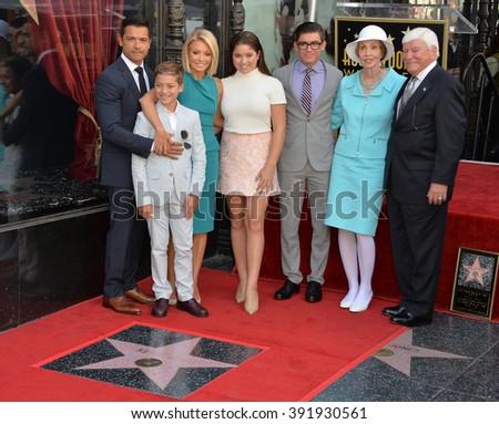 LOS ANGELES, CA - OCTOBER 12, 2015: Kelly Ripa & actor husband Mark Consuelos & children Joaquin, 12, Michael 18, & Lola, 14, & Kelly's parents at her Hollywood Walk of Fame star ceremony. - stock photo