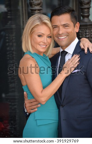 LOS ANGELES, CA - OCTOBER 12, 2015: Kelly Ripa & actor husband Mark Consuelos on Hollywood Boulevard where she was honored with a star on the Walk of Fame. - stock photo