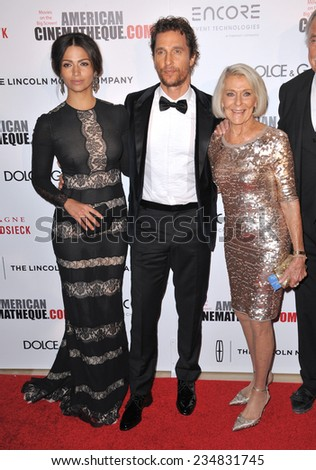 LOS ANGELES, CA - OCTOBER 21, 2014: Matthew McConaughey & wife Camila Alves & mother Kay McConaughey at the American Cinematheque Award Gala honoring Matthew McConaughey at the Beverly Hilton Hotel.  - stock photo