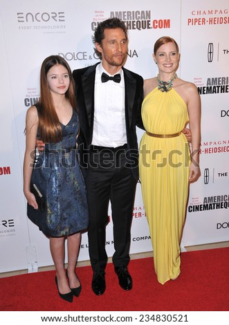 LOS ANGELES, CA - OCTOBER 21, 2014: Matthew McConaughey with Jessica Chastain (right) & Mackenzie Foy at the American Cinematheque Award Gala honoring Matthew McConaughey at the Beverly Hilton Hotel.  - stock photo