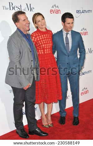 """LOS ANGELES, CA - OCTOBER 7, 2014: Michelle Monaghan & James Marsden & writer Nicholas Sparks (left) at the world premiere of their movie """"The Best of Me"""" at the Regal Cinemas LA Live.  - stock photo"""