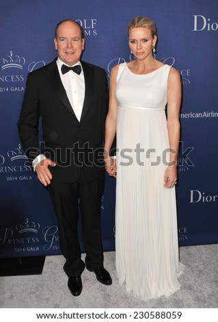 LOS ANGELES, CA - OCTOBER 8, 2014: Prince Albert II of Monaco & Princess Charlene of Monaco at the 2014 Princess Grace Awards Gala at the Beverly Wilshire Hotel, Beverly Hills.  - stock photo