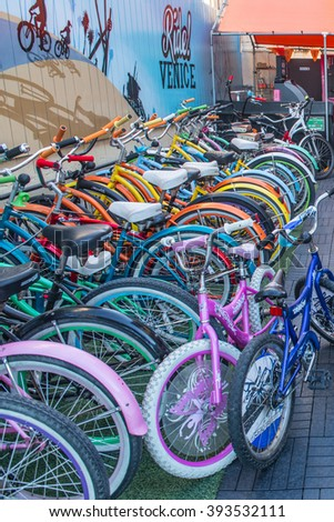 LOS ANGELES, CA - OCTOBER 11th,  2015: One of Venice Beach many bycicle rental places by the boardwalk bike path. - stock photo