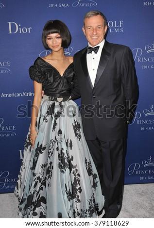 LOS ANGELES, CA - OCTOBER 8, 2014: Zendaya Coleman & Walt Disney president Robert A. Iger at the 2014 Princess Grace Awards Gala at the Beverly Wilshire Hotel, Beverly Hills. - stock photo