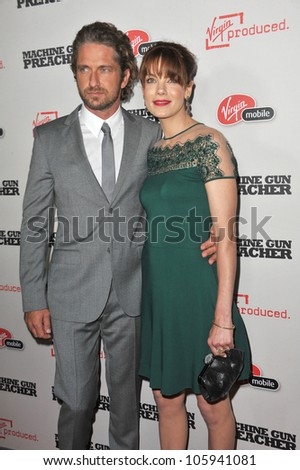 "LOS ANGELES, CA - SEPTEMBER 21, 2011: Gerard Butler & Michelle Monaghan at the premiere ""Machine Gun Preacher"" at the Samuel Goldwyn Theatre. September 21, 2011  Los Angeles, CA - stock photo"