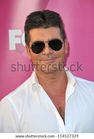 """LOS ANGELES, CA - SEPTEMBER 11, 2012: Simon Cowell at the season two premiere of """"X Factor USA"""". He had his handprints set in cement at Grauman's Chinese Theatre - stock photo"""