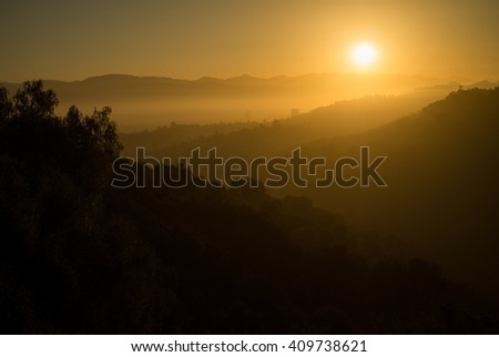 Los Angeles, CA - The sun rises over the San Fernando Valley on a foggy morning. - stock photo