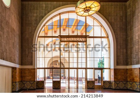 LOS ANGELES, CA/USA - AUGUST 30, 2014. Interior space of Union Station. Los Angeles Union Station is the largest railroad passenger terminal in the Western United States. - stock photo