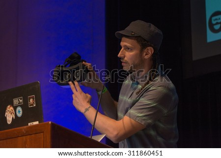 Los Angeles, CA - USA - August 29, 2015: Vangelis Lympouridis, PhD Project Coordinator at School of Cinematic Arts - MxR Studio during VRLA Expo, virtual reality exposition event - stock photo