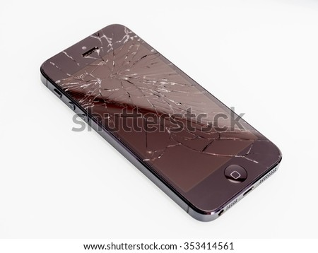 Los Angeles, CA, USA - December 07, 2015: Broken Apple iPhone with cracked screen on white background, selective focus - stock photo