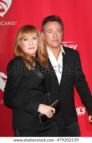 Los Angeles, CA, USA; February 2, 2013; Patti Scialfa and Bruce Springsteen arrive to the MusiCares 2013 Person Of The Year Tribute in Los Angeles, California.