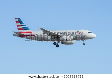 LOS ANGELES, CA/USA - JULY 25, 2015: American Airlines jet is shown approaching LAX for landing.