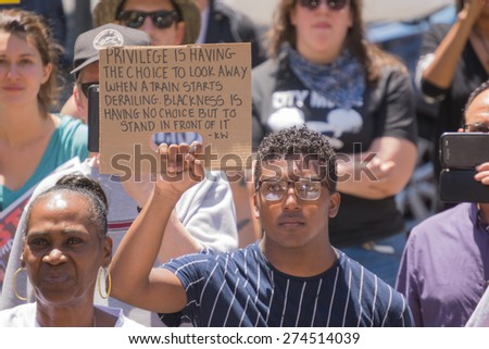 Los Angeles, CA, USA - May 02, 2015: Man holding sign during march against the death of Freddie Gray, a man of Baltimore who was seriously injured in police custody. - stock photo
