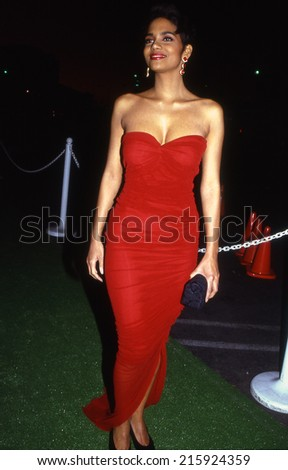 LOS ANGELES, CALIFORNIA  - circa 1991:  Halle Berry arriving at a star studded event - stock photo