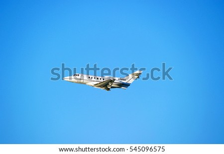 LOS ANGELES/CALIFORNIA - DEC. 17, 2016: Corporate owned British Aerospace HS 125-700A aircraft is airborne as it departs Los Angeles International Airport, Los Angeles, California USA