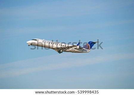LOS ANGELES/CALIFORNIA - DEC. 4, 2016: United Airlines Bombardier CRJ-200ER aircraft is airborne as it departs Los Angeles International Airport, Los Angeles, California USA