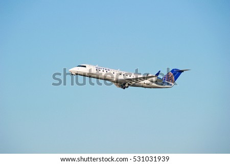 LOS ANGELES/CALIFORNIA - DEC. 3, 2016: United Express Bombardier CRJ-200ER aircraft is airborne as it departs Los Angeles International Airport, Los Angeles, California USA