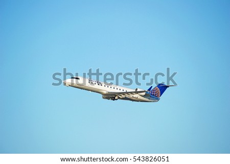 LOS ANGELES/CALIFORNIA - DEC. 17, 2016: United Express Bombardier CRJ-200ER aircraft is airborne as it departs Los Angeles International Airport, Los Angeles, California USA