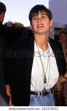 LOS ANGELES, CALIFORNIA - exact date unknown - circa 1990 - Demi Moore arriving at a celebrity event - stock photo