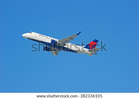 LOS ANGELES/CALIFORNIA - FEB. 21, 2016: Delta Airlines Embraer ERJ-175LR  is airborne as it departs Los Angeles International Airport, Los Angeles, California USA - stock photo