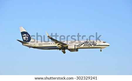 LOS ANGELES/CALIFORNIA - JULY 12, 2015: Alaska Airlines Boeing 737 on approach to runway at Los Angeles International Airport in Los Angeles, California, USA - stock photo