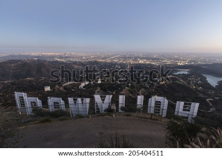 LOS ANGELES, CALIFORNIA - July 2, 2014:  Back of the Hollywood sign above the city of Los Angeles at dusk.   - stock photo
