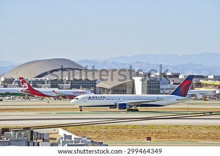 LOS ANGELES/CALIFORNIA - JULY 12, 2015: Delta Airlines Boeing 767 is taxiing the runway after arriving at Los Angeles International Airport in Los Angeles, California, USA - stock photo