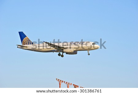 LOS ANGELES/CALIFORNIA - JULY 12, 2015: United Airlines Airbus A320 on approach to runway at Los Angeles International Airport in Los Angeles, California, USA - stock photo
