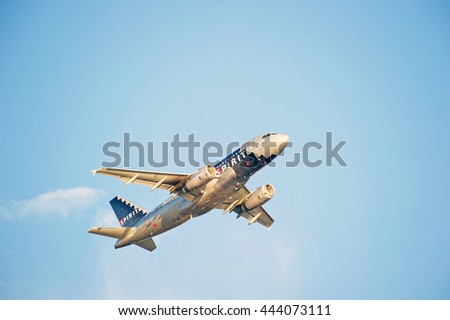 LOS ANGELES/CALIFORNIA - JUNE 18, 2016: Spirit Airlines Airbus A319 commercial aircraft is airborne as it departs Los Angeles International Airport, Los Angeles, California USA - stock photo