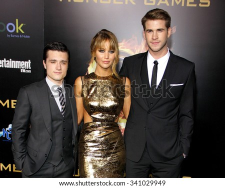 """LOS ANGELES, CALIFORNIA - March 12, 2012. Josh Hutcherson, Jennifer Lawrence and Liam Hemsworth at the Los Angeles premiere of """"The Hunger Games"""" held at the Nokia L.A. Live, Los Angeles.  - stock photo"""