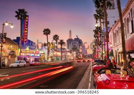 LOS ANGELES, CALIFORNIA - MARCH 1, 2016: Traffic on Hollywood Boulevard at dusk. The theater district is a famous tourist attraction. - stock photo