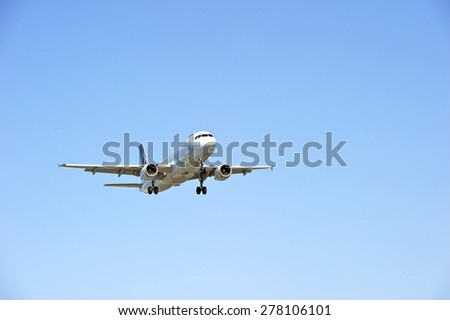 LOS ANGELES/CALIFORNIA - MAY 10, 2015: Air Canada Airlines commercial jet on approach to runway at Los Angeles International Airport in Los Angeles, California, USA