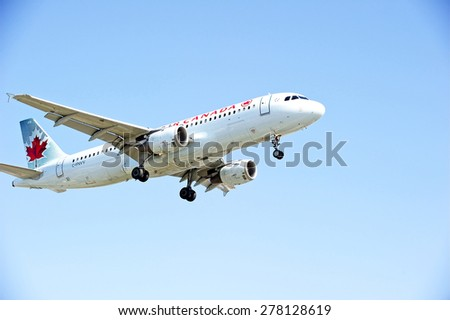 LOS ANGELES/CALIFORNIA - MAY 10, 2015: Air Canada Airlines commercial jet on approach to runway at Los Angeles International Airport in Los Angeles, California, USA - stock photo