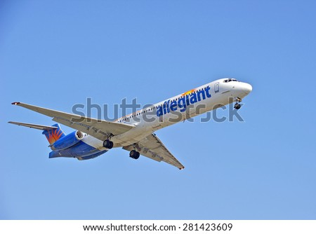 LOS ANGELES/CALIFORNIA - MAY 10, 2015: Allegiant Airlines commercial jet on approach to runway at Los Angeles International Airport in Los Angeles, California, USA