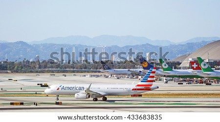 LOS ANGELES/CALIFORNIA - MAY 22, 2016: American Airlines Airbus A321 commercial aircraft taxiing along runway upon arrival to Los Angeles International Airport, Los Angeles, California USA  - stock photo