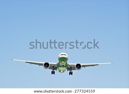 LOS ANGELES/CALIFORNIA - MAY 10, 2015: Commercial Cargo jet on approach to runway at Los Angeles International Airport in Los Angeles, California, USA - stock photo