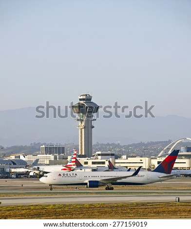 LOS ANGELES/CALIFORNIA - MAY 10, 2015: Delta Airlines commercial jet taxiing on the runway at Los Angeles International Airport in Los Angeles, California, USA - stock photo