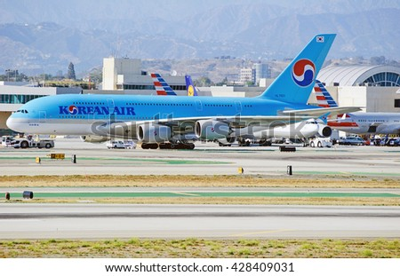 LOS ANGELES/CALIFORNIA - MAY 22, 2016: Korean Air Airbus A380-861 is being towed along the tarmac from the terminal at Los Angeles International Airport, Los Angeles, California USA   - stock photo