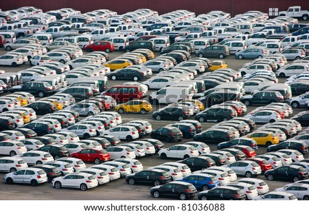 LOS ANGELES, CALIFORNIA -  MAY 29: New cars arrive at Los Angeles Sea Port on May 29, 2011 in Los Angeles, California. Auto terminal has a capacity to accommodate 8000 cars. - stock photo