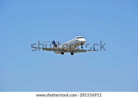 LOS ANGELES/CALIFORNIA - MAY 10, 2015: SkyWest Airlines commercial jet on approach to runway at Los Angeles International Airport in Los Angeles, California, USA - stock photo