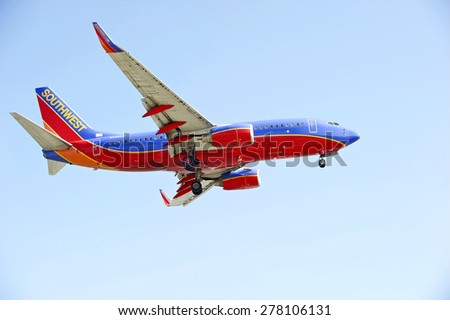 LOS ANGELES/CALIFORNIA - MAY 10, 2015: Southwest Airlines commercial jet on approach to runway at Los Angeles International Airport in Los Angeles, California, USA - stock photo