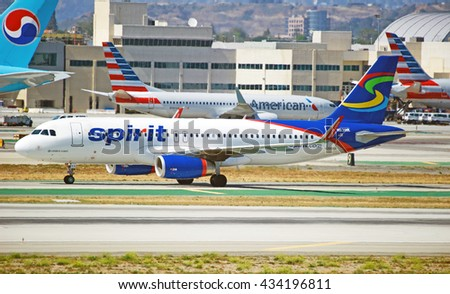 LOS ANGELES/CALIFORNIA - MAY 22, 2016: Spirit Airlines Airbus A320 commercial aircraft taxiing along runway upon arrival to Los Angeles International Airport, Los Angeles, California USA - stock photo